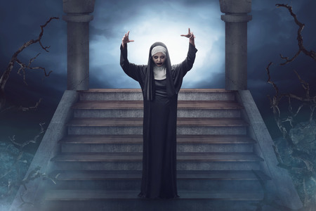 sinful: Devil asian nun walks down the ruins stairs on the forest