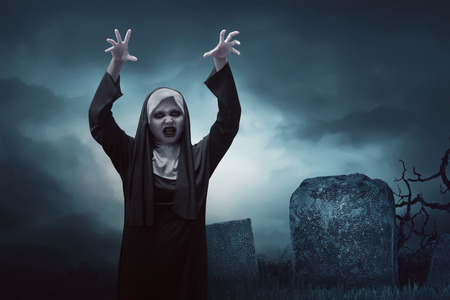 incubus: Scary young asian nun woman in graveyard at night