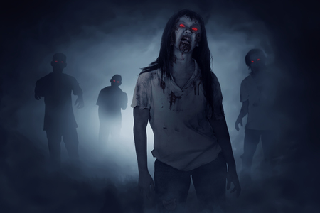 entities: Some zombies walking around on the foggy night Stock Photo