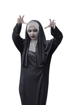 incubus: Asian woman with evil nun costume isolated over white background