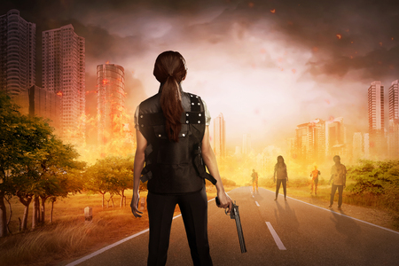 punish: Asian woman with vest and gun want to punish the zombies Stock Photo