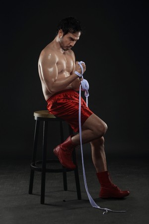 wrist strap: Young asian boxer male wearing white strap on wrist