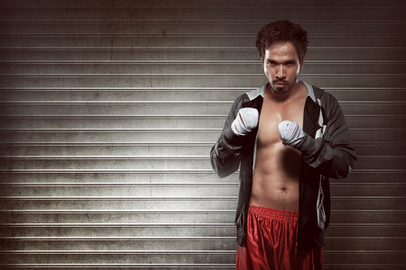 wrist strap: Portrait of an asian boxer in robe with white strap on wrist hand
