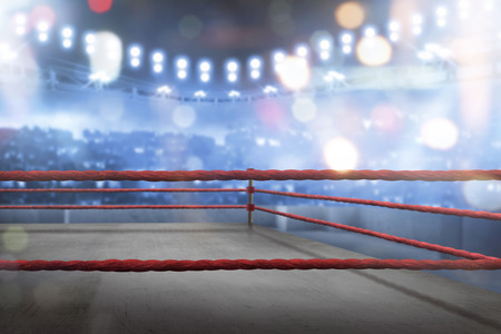 Empty boxing ring with red ropes for match in the stadium arena Stock Photo