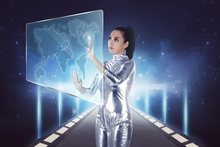 Pretty asian woman wearing latex jumpsuit. Inside cyber world concept