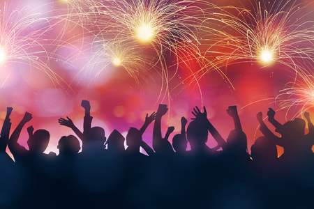 Silhouette of party people celebrate new year eve Stock Photo