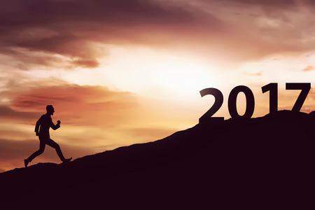 man symbol: Image of silhouette man running on the hill toward 2017