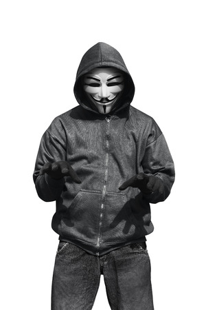 vendetta: Portrait of man wearing anonymous mask isolated against white background Stock Photo