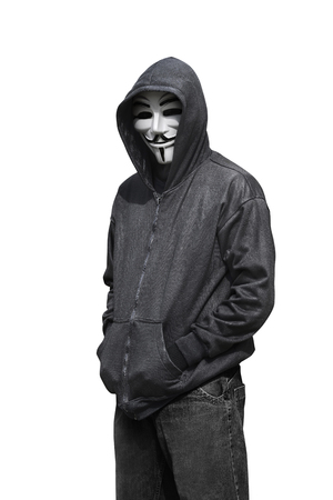 vendetta: Portrait of man wearing anonymous mask isolated against white background Editorial