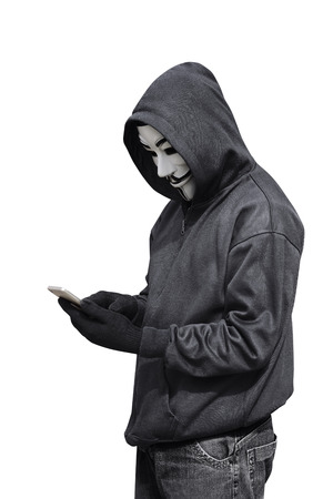 vendetta: Hacker man with mask using a smartphone isolated on white background