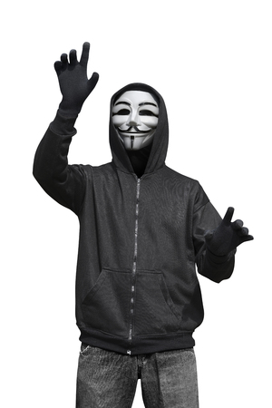 Man with anonymous mask touching something isolated over white background