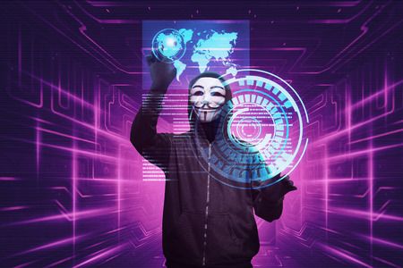 Hacker man with anonymous mask hacking system security on virtual screen
