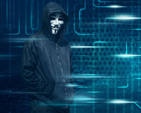 Hacker with mask on dark green digital screen background