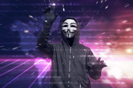Hooded hacker with mask hacking binary system security code on the virtual screen