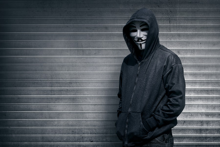 vendetta: Anonymous man on grey shutter door background