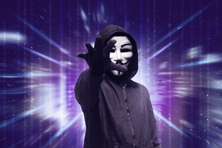 Dangerous hacker with mask want to stealing data over binary code in background