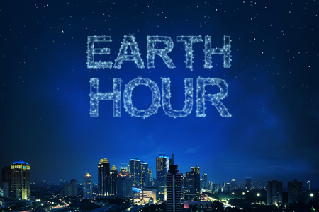 Earth Hour greeting from light the star on skyline above night city background