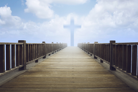 jesus praying: Bright cross symbol on the cloud in the end of wooden pathway Stock Photo