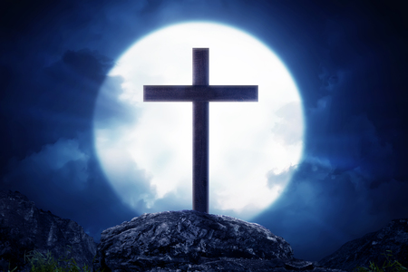 Wooden crosses standing on rock hill with moonlight at night