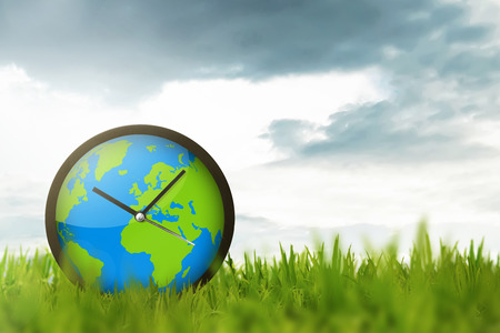 Clock of globe on the meadow. Earth Hour Concept.