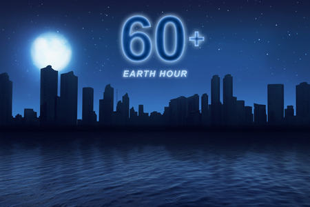 Earth hour message to turn off electrical equipment in 60 minutes with nightlife at city background