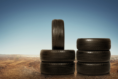 Group of worn tires, shooting over desert background Stock Photo