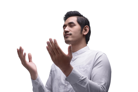 Religious asian muslim man praying to god isolated over white background Archivio Fotografico