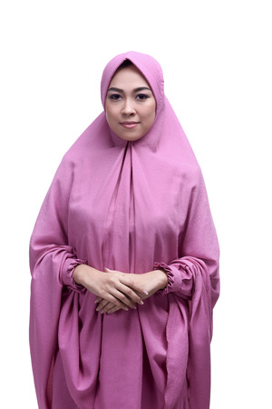 Young asian muslim woman wearing hijab smiling isolated over white background