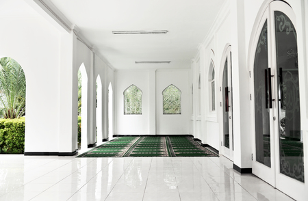 Terrace mosque interior with carpet and tiled floor at daylight