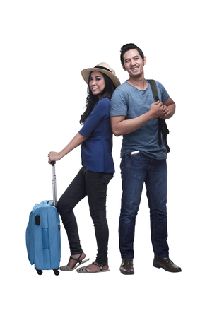 Traveler asian couple with backpack and suitcase standing isolated over white background