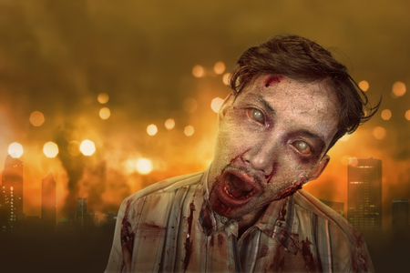 cruel: Portrait of asian zombie man with wounded face against burning city background