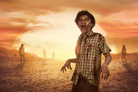 Crowd of aggresive asian zombies walking around over sunset background
