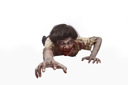 Portrait of asian undead man crawling isolated over white background
