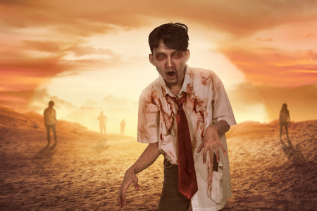 Crowd of aggressive asian zombies with bloody face on sunset background