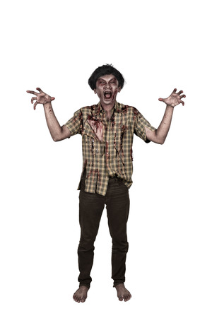 Portrait of scary asian zombie man hand with a claw standing isolated over white background