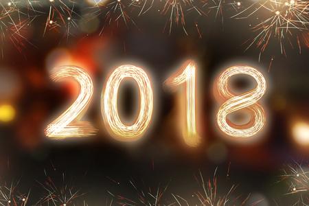 Sparkling fireworks with 2018 shape on sparkle background. Happy New Year 2018 Standard-Bild