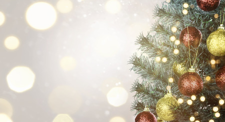 Closeup of Christmas tree with colorful lamp decoration over blurred light background 版權商用圖片