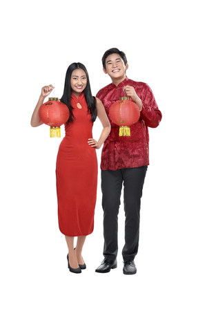Portrait of chinese couple holding red lanterns posing isolated over white background Stock Photo