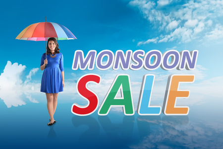 Pretty asian woman with umbrella on monsoon sale. Monsoon sale concept