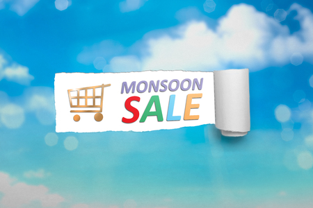 Ripped paper with text of Monsoon sale. Monsoon sale concept Stock Photo