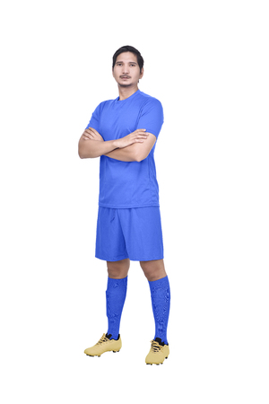 Young asian soccer player with blue jersey standing posing isolated over white background