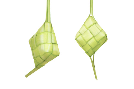 Rice dumpling or ketupat is traditional food for festive season isolated over white background