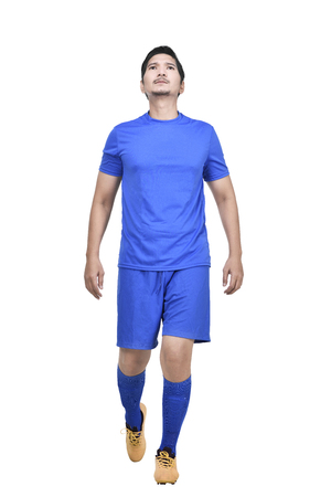 Handsome asian athlete man with blue jersey standing isolated over white background Standard-Bild