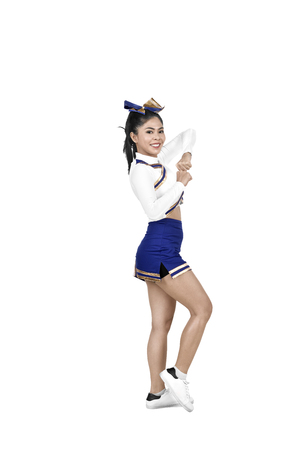 Young asian cheerleader in action isolated over white background