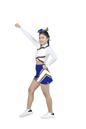 Cute asian cheerleader in action isolated over white background Stock Photo