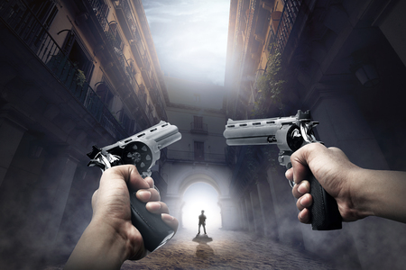 Hands with guns ready to shoot the walking zombie on abandoned place