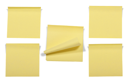 Collection of yellow notepads isolated over white background