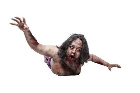 Portrait of zombie man crawling posing isolated over white background