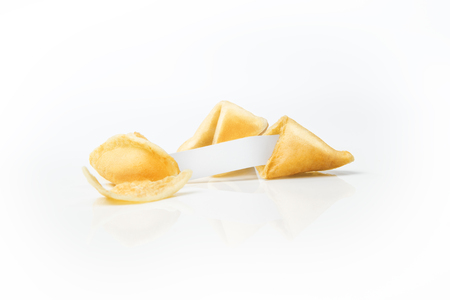 Fortune cookies with blank white paper isolated over white background
