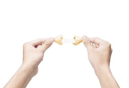 Human hand opening a fortune cookies with blank paper inside it isolated over white background Archivio Fotografico